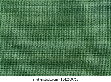 Velcro texture. Green fabric background. Extreme close-up.