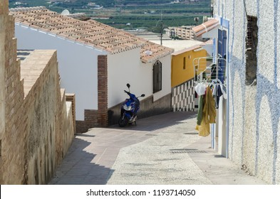 VELEZ-MALAGA, SPAIN - AUGUST 24, 2018 Empty streets during a siesta in a Spanish city, characteristic architecture in the south of Spain