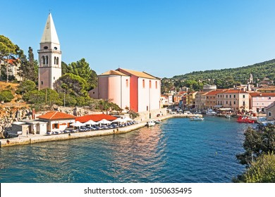 Veli Losinj, Losinj, Croatia - 08/27/2017: Cityscape of Veli Losinj with church and harbour