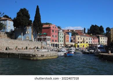 Veli Losinj, Croatia - April 16, 2014: Small harbor ov Veli Losinj protects the boats from high waves
