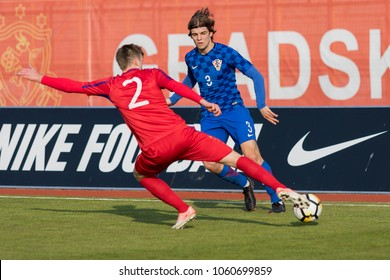 VELIKA GORICA, CROATIA - MARCH 27, 2018: European Under-21 Championship Qualifying Round. Match between Croatia and Moldova 4-0. In action Borna SOSA (3) and Andrei MACRITCHII (2)