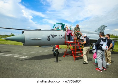 VELIKA GORICA, CROATIA - MAY 13, 2017 : People sightseeing the MiG 21 military airplane exhibited at the AIRVG2017, the aviation day in Velika Gorica, Croatia.