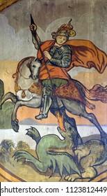 VELIKA MLAKA, CROATIA - MARCH 28: Saint George slaying the dragon, altarpiece in the Church of the Saint Barbara in Velika Mlaka, Croatia on March 28, 2017.