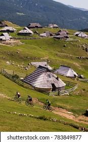 Velika Planina / Slovenia August 26 2017 : Cyclists on Velika Planina / Big Pasture Plateau mountain plateau in the Kamnik–Savinja Alps northeast of Kamnik, Slovenia