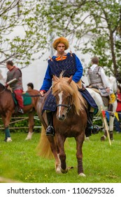 VELIKIY NOVGOROD, RUSSIA - May 19, 2018: Armored warrior of the Great Horde on a horse with a cavalry sword at medieval festival Hanseatic Days.