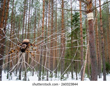 VELIKIY USTYUG, RUSSIA, MARCH 1, 2015, a Huge wooden spider sitting in a web of strong ropes on the trail of fairy tales in the Estate of Father Frost