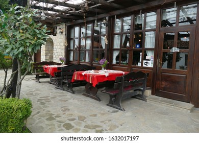 VELIKO TARNOVO, BULGARIA - APR 14, 2019 - Outdoor restaurant with red tables, Arbanasi, Bulgaria