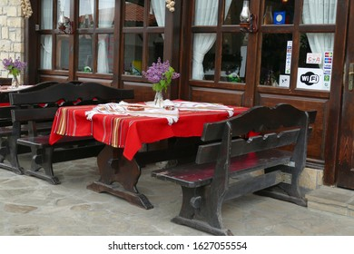 VELIKO TARNOVO, BULGARIA - APR 15, 2019 - Outdoor restaurant with red tables, Arbanasi, Bulgaria