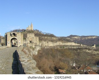 Veliko Tarnovo, Bulgaria - February 2018: View of mighty walls of the Tsarevets fortress early in spring, with two gates and the patriarch's cathedral on the top of the hill