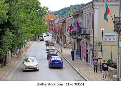 Veliko Tarnovo, Bulgaria - July 30, 2018: people are walking by the narrow street in Veliko Tarnovo, Bulgaria
