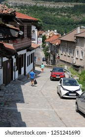 VELIKO TARNOVO, BULGARIA - JUNE 13, 2018: : People walk down the sytreet in the Old town
