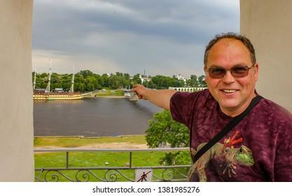 Veliky Novgorod, Russia. 17.06.12. Man with glasses on the bell tower of the Novgorod Kremlin