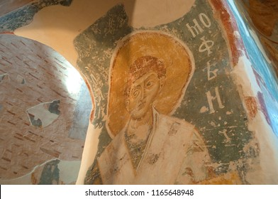 Veliky Novgorod, Russia - August 17, 2018. Interior view of the Saviour Church on Nereditsa. Fresco of Saint Timothy in the arch of the passage from the deacon to the altar