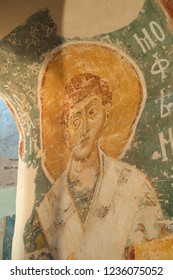 Veliky Novgorod, Russia - August 17, 2018. Interior of the Saviour Church on Nereditsa. Fresco of Saint Timothy in the arch of the passage from the deacon to the altar
