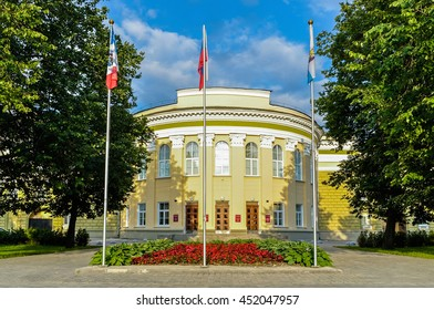 VELIKY NOVGOROD, RUSSIA - JUNE 22, 2016. Facade of the regional administration building of Veliky Novgorod, architecture closeup view with Russian and regional flags on the flagpoles