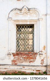 Veliky Novgorod, Russia. Lancet window decorated with stucco details at the facade of Resurrection Cathedral of Derevyanitsky monastery in Veliky Novgorod