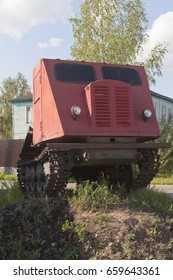 Veliky Ustyug, Vologda region, Russia - August 12, 2016: Skidder tractor TDT-40 installed as a monument on the earthen pedestal in Veliky Ustyug, Vologda region