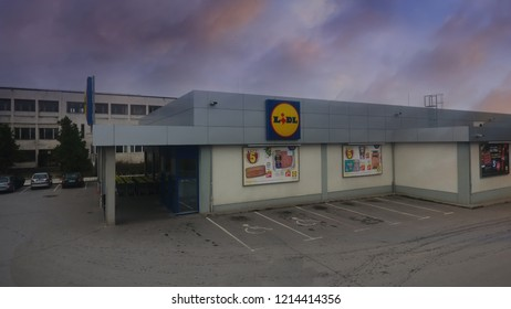 VELINGRAD, BULGARIA - JULY 02, 2018: LIDL supermarket and logo aerial view at the sunset. Lidl is a German global discount supermarket chain, that operates over 10,000 stores across Europe.