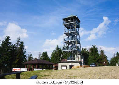 Velka Cantoryje, Czech republic - June, 19, 2019: Lookout tower on Velka Cantoryje hill on czech-polish borders in Slezske Beskydy mountains. Summer morning, blue sky, no people.