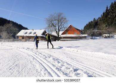 VELKE KARLOVICE, CZECH REPUBLIC - DECEMBER 04, 2016: Two skiers start cross country season in Velke Karlovice, December 4, 2016, Czech republic
