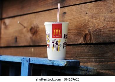 VELKE KARLOVICE, CZECH REPUBLIC - JANUARY 1, 2015: McDonalds plastic cups for soda. McDonald's Corporation is the world's largest chain of hamburger fast food restaurants.