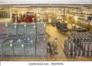 Velke Popovice, Czech Republic - November 11, 2016: Modern beer brewery, conveyor, stock of aluminum kegs for beer.