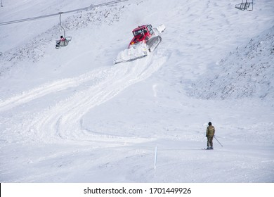 Velouchi, Karpenissi, Greece/ January, 2019: Snow groomer machine prepares the snow for recreational activities in a slope at Velouchi mountain in Karpenissi, Greece