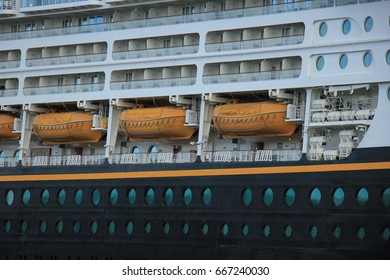 Velsen, the Netherlands - June, 27th 2017: Disney Magic on North Sea Canal, detail of cabins and lifeboats