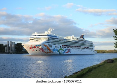 Velsen, the Netherlands - May 11th, 2019: Norwegian Pearl in North Sea Canal, maiden call to Amsterdam. Operated by Norwegian Cruise Line, built by Meyer Werft, Germany