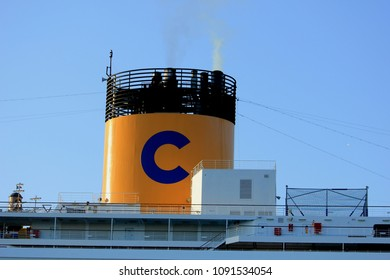 Velsen, The Netherlands - May, 15th 2018: Costa Favolosa on North Sea Channel towards North Sea, detail of funnel