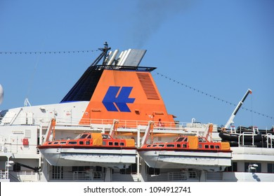 Velsen, the Netherlands - May 5th 2018: MS Hanseatic in North Sea Canal, operated by Hapag-Lloyd Cruise Line, detail of the funnel