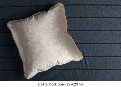 velvet pillow on the bed sheet fabric
