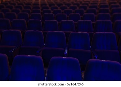 velvet seats for spectators in the theater or cinema