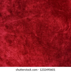 velvet texture background red color. Christmas festive baskground. expensive luxury, fabric, material, cloth.Copy space.