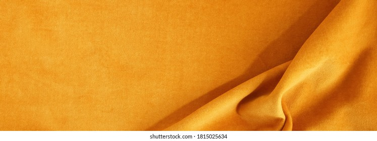 velvet texture fortuna gold color background banner, expensive luxury fabric, material,  wallpaper. copy space