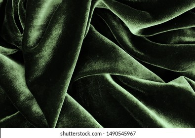 velvet texture green color background, expensive luxury fabric, material,  wallpaper. copy space