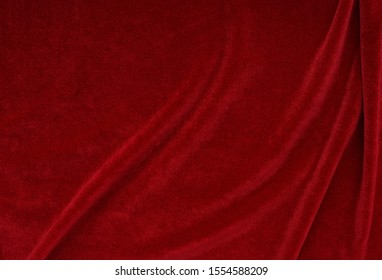 velvet texture red color background, expensive luxury fabric,  wallpaper. copy space
