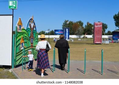 "Velyki Sorochintsi, UKRAINE - AUGUST 25, 2017: Figure of Nikolai Gogol going to the concert at national Ukrainian annual market ""Sorochinska Yrmorka"", Ukraine"