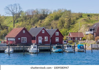 VEN, SWEDEN - MAY 03, 2017: The small Harbor at the Island Ven in Oresund between Denmark and Sweden when spring time. The hills of the Island in the background