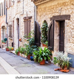 VENCE, FRANCE, on March 8, 2018. The typical city street of old stone houses characteristic of the small mountain town in Provence.
