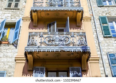 VENCE, FRANCE,6 of March, 2018. The sun lights a facade of the old building with a beautiful openwork balcony