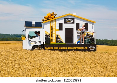 Vendeuvre-sur-Barse, France - 6 July, 2017: The vehicle of Century 21 passes through a region of wheat fields in the Publicity Caravan before the cyclists during the stage 6 of Tour de France 2017.
