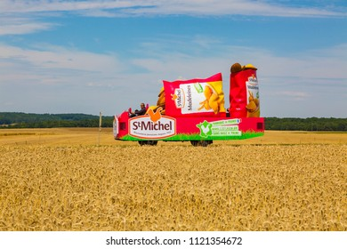 Vendeuvre-sur-Barse, France - 6 July, 2017: The vehicle of St. Michel Madeleines passes through a region of wheat fields in the Publicity Caravan during the stage 6 of Tour de France 2017.