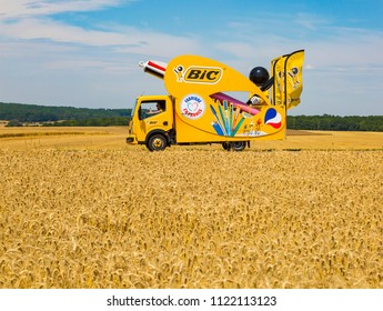Vendeuvre-sur-Barse, France - 6 July, 2017: The fancy vehicle of BIC passes through a region of wheat fields in the Publicity Caravan before the cyclists during the stage 6 of Tour de France 2017.