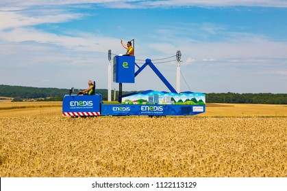 Vendeuvre-sur-Barse, France - 6 July, 2017: The vehicle of Endis passes through a region of wheat fields in the Publicity Caravan before the cyclists during the stage 6 of Tour de France 2017.