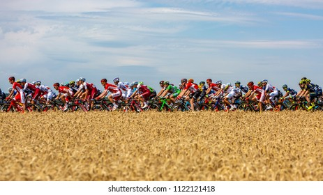 Vendeuvre-sur-Barse, France - 6 July, 2017: The peloton passes through a region of wheat fields during the stage 6 of Tour de France 2017.