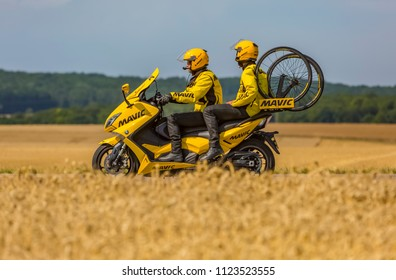 Vendeuvre-sur-Barse, France - 6 July, 2017: The bike of Mavic passes through a region of wheat fields in the Publicity Caravan before the cyclists during the stage 6 of Tour de France 2017.