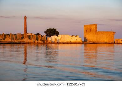 Vendicari Saline ancient tuna factory at sunset view