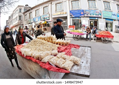 Vending with pushing cart at the street market, Turpan, Xinjiang, One Belt One Road (OBOR), China, 3/24/11.