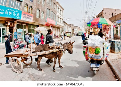 Vendor with donkey pulling cart at the street market, Turpan, Xinjiang, One Belt One Road (OBOR), China, 3/24/11.